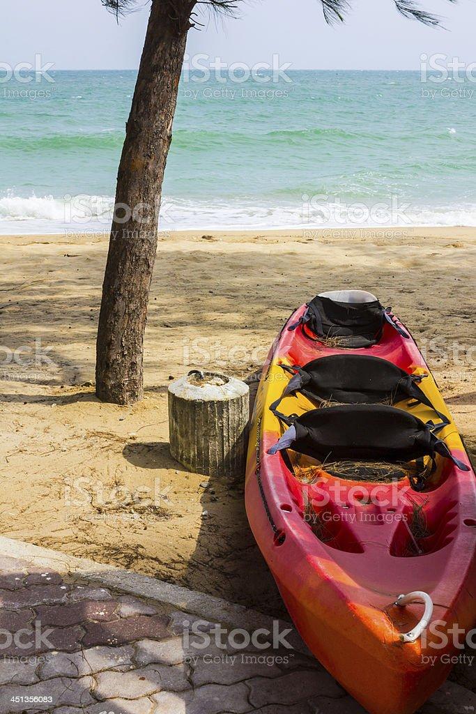 Red kayak on beach royalty-free stock photo