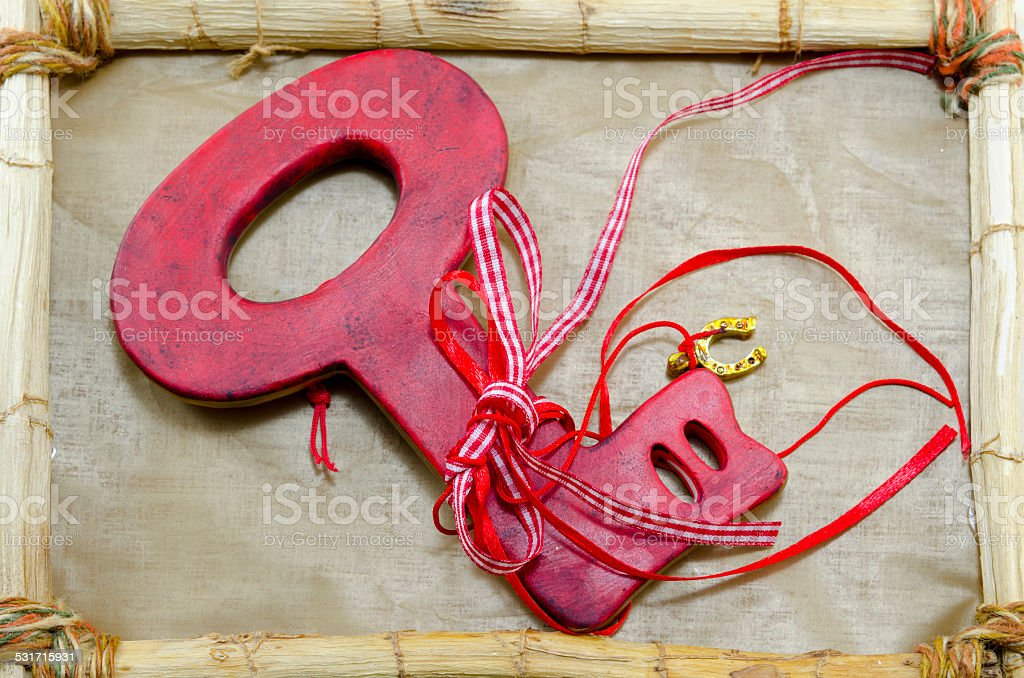 Red key on a wooden frame royalty-free stock photo