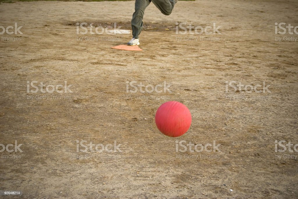 red kickball approach stock photo