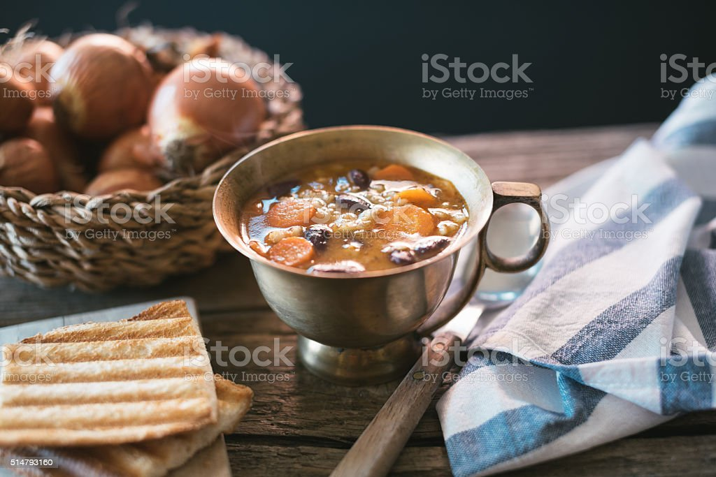 Red kidney bean soup with carots and barley stock photo