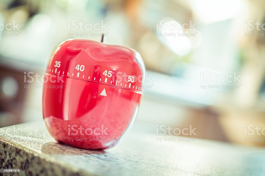 Red Kitchen Egg Timer In Apple Shape stock photo
