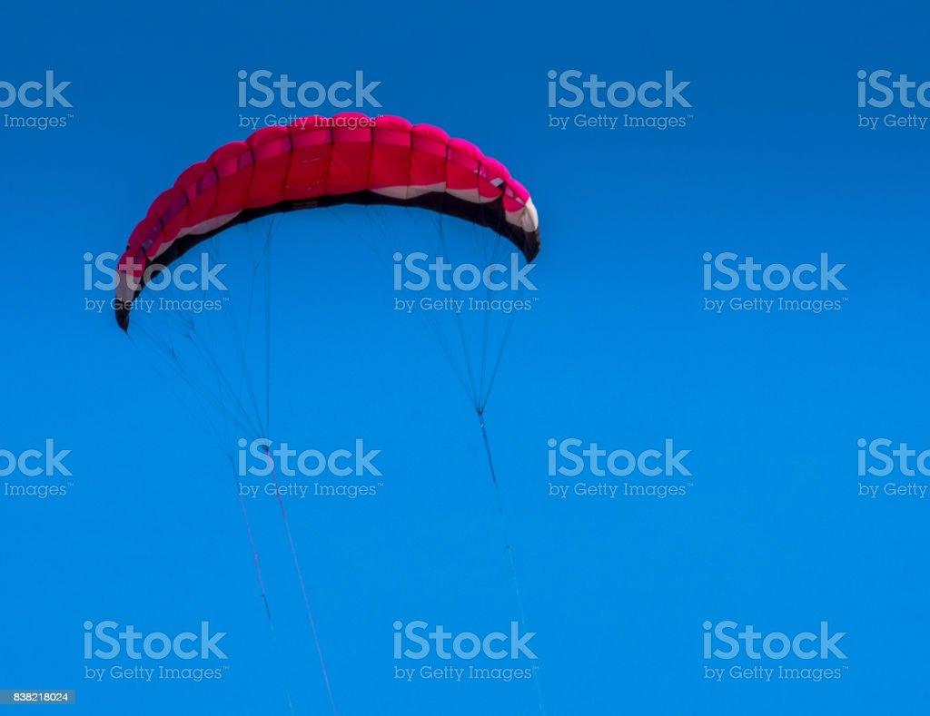 Red Kite in blue sky stock photo