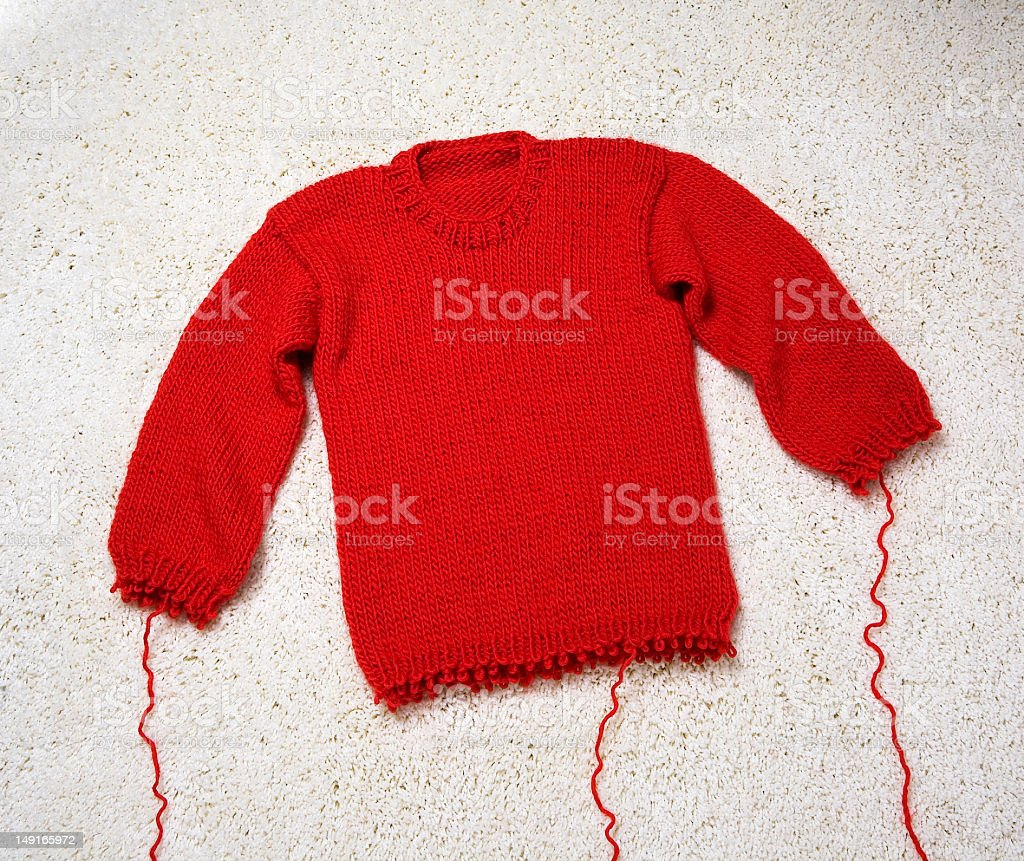 red knit sweater stock photo