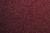 Red knitted fabric texture, closeup