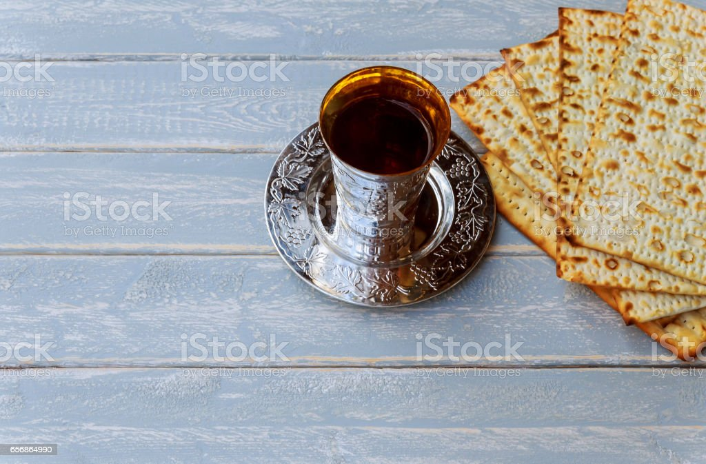 Red kosher wine with matzah or matza and a Passover Haggadah stock photo