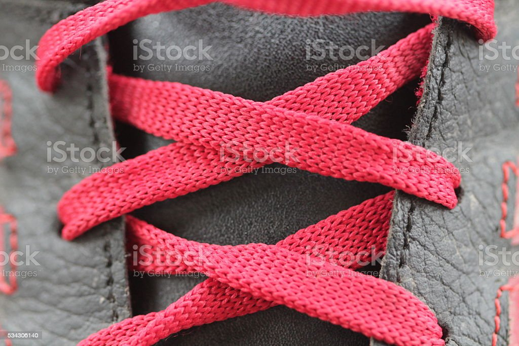 Red laces andred shoes stock photo