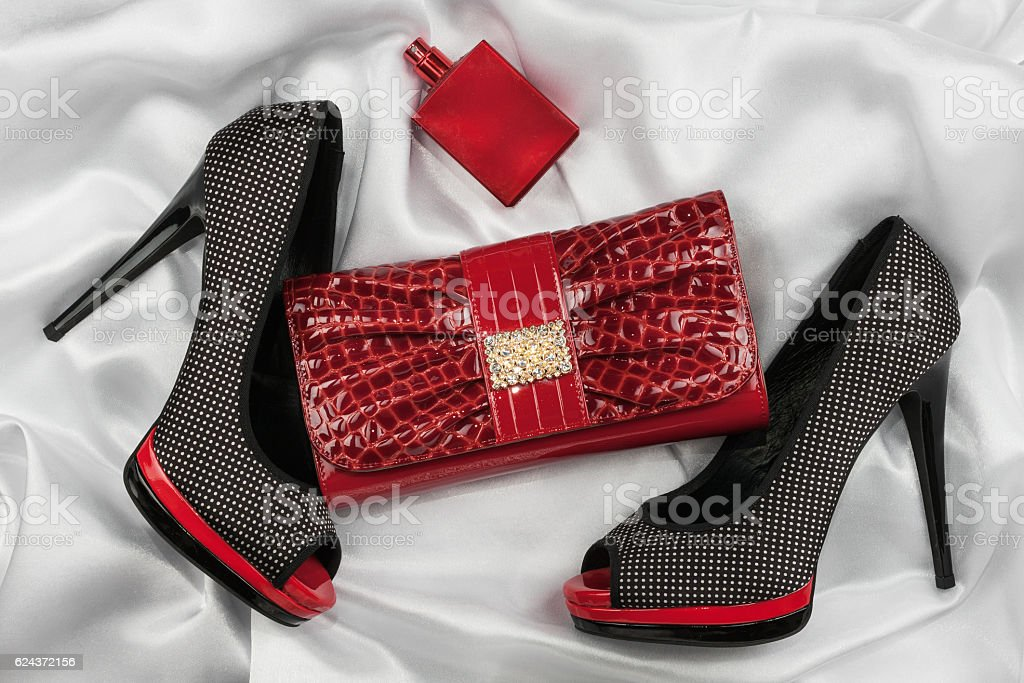 Red lacquer bag, perfume and shoes with toeless stock photo