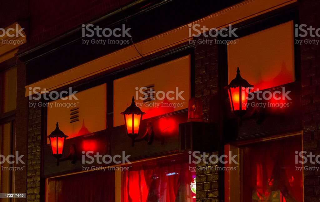 Red lamps lighting a red light district stock photo