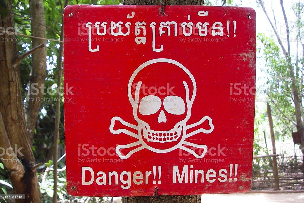 Red landmine warning sign in Cambodia stock photo