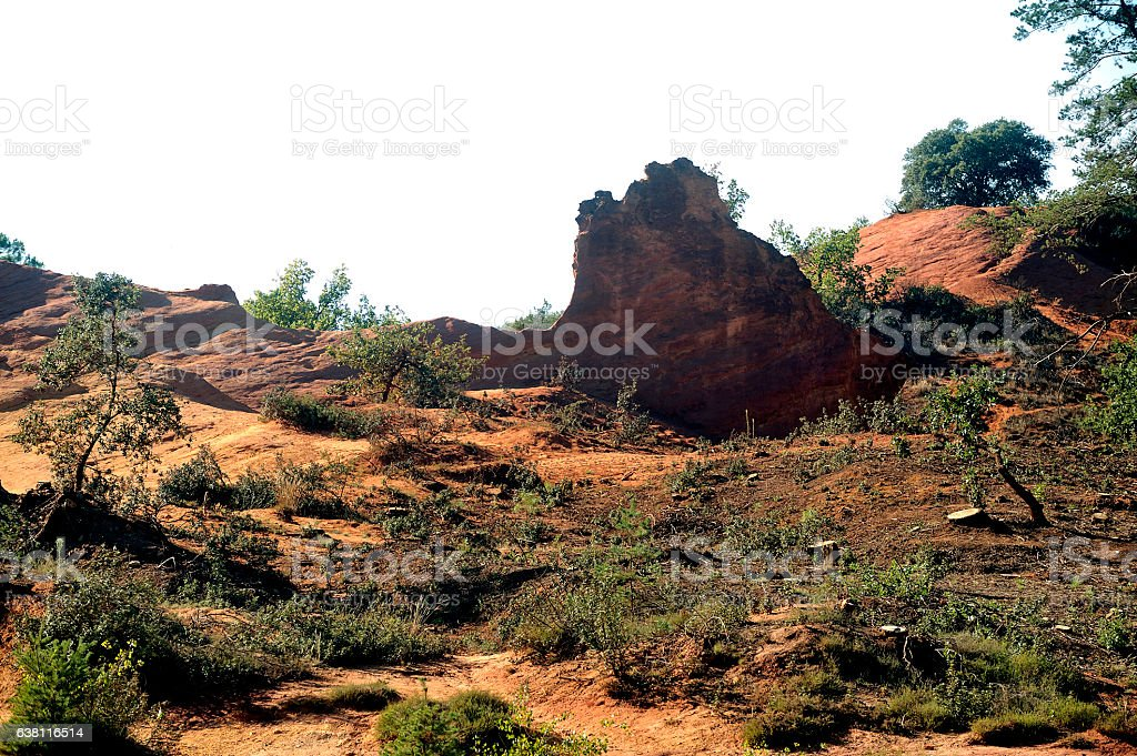 red landscape dug by six generations of miners ocher stock photo