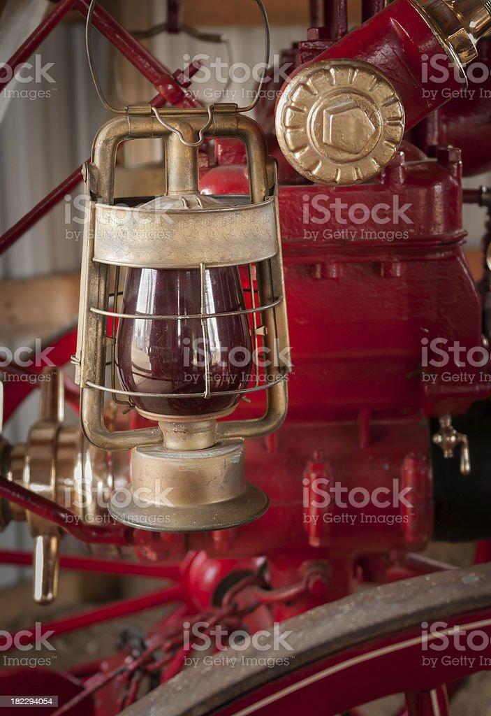 Red Lantern Hangs on 1876 Fire Engine stock photo