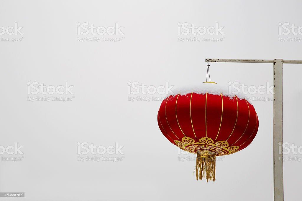 red lantern in snow stock photo