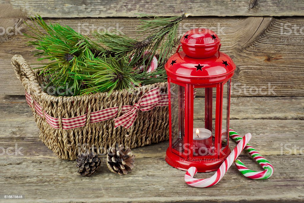Red lantern with basket and  Candy Cane on wooden background stock photo