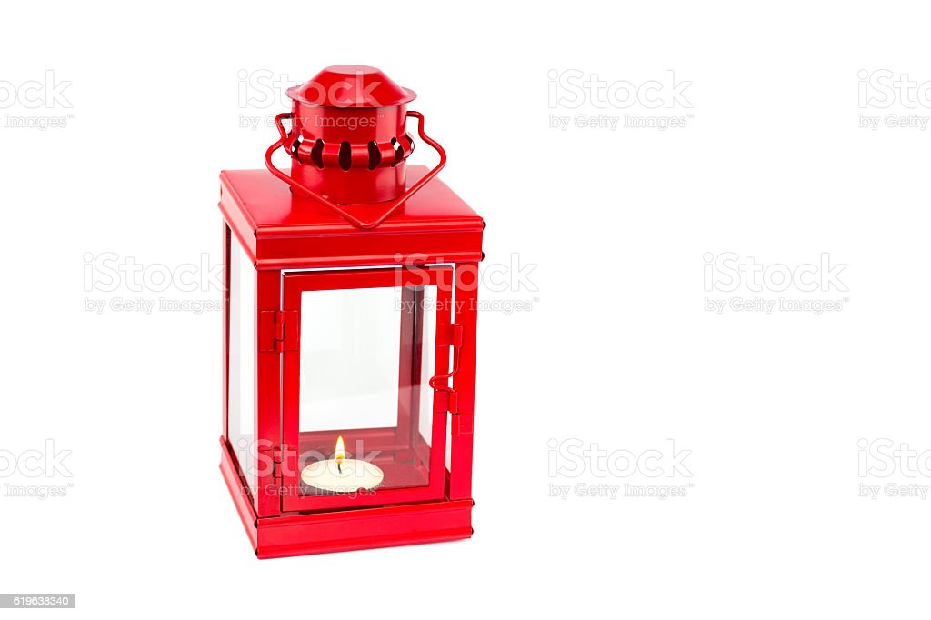 Red lantern with burning tealight on white background stock photo