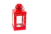 Red lantern with burning tealight on white background