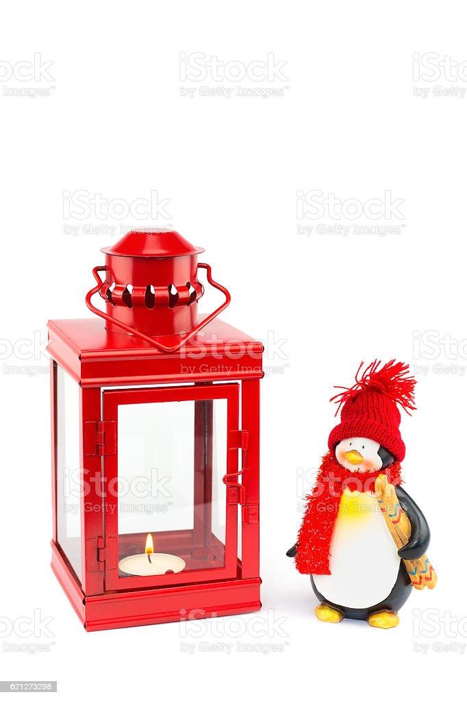 Red lantern with penguin figurine on white stock photo