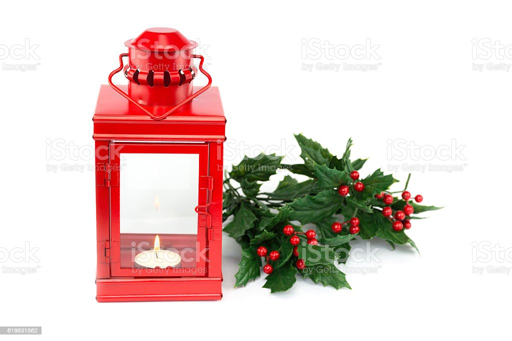 Red lantern with tealight holly twigs and berries stock photo