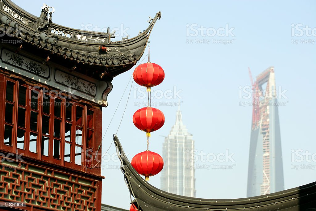Red lanterns hanging from temple roof in Shanghai royalty-free stock photo