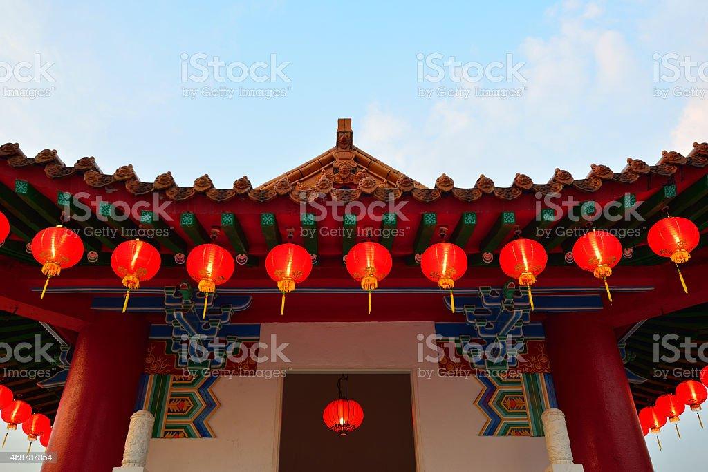 Red lanterns hanging on a Gazebo stock photo