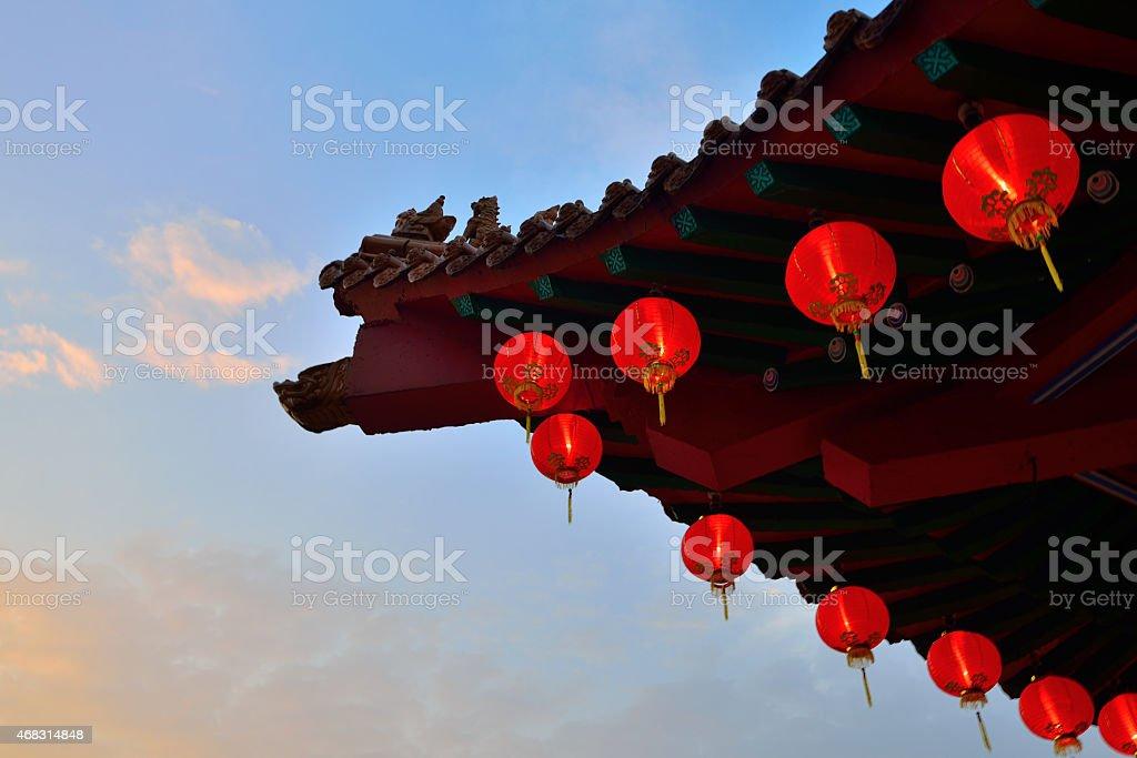 Red lanterns hanging outside a gazebo stock photo