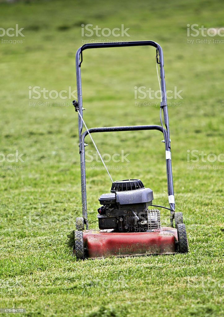 Red lawn mower royalty-free stock photo