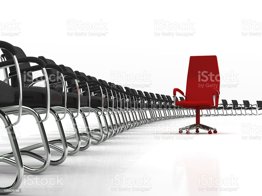 red leader chair with black chairs stock photo
