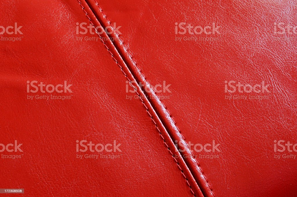 red leather background with stitching stock photo