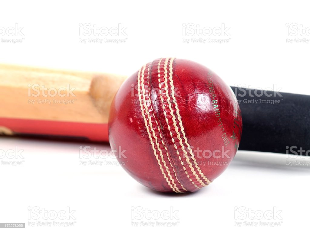 Red leather cricket ball with red and tan stripes royalty-free stock photo