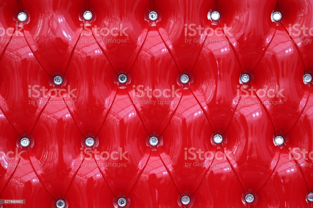 Red leather pad with fake diamond buttons stock photo