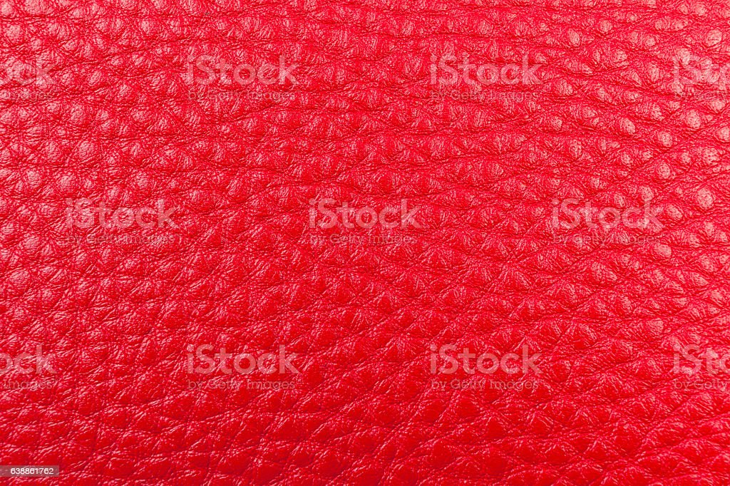 red leather pebble texture background close up stock photo