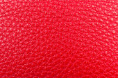 red leather pebble texture background close up