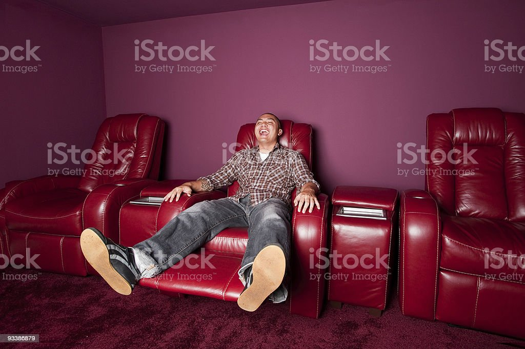Red Leather Recliner Man Laughs royalty-free stock photo