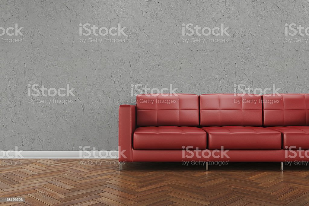 Red leather sofa on a wooden tile floor stock photo