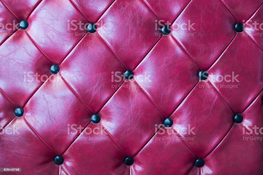 red leather upholstery background and texture stock photo