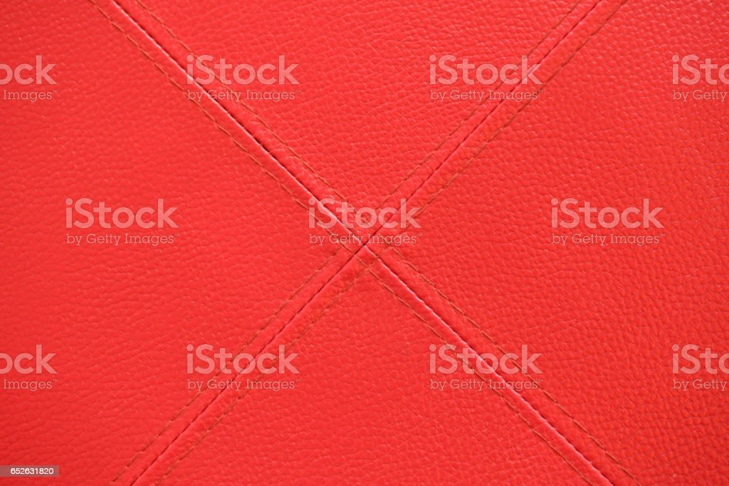 Red leather with stitch texture and crosswise  symbol stock photo