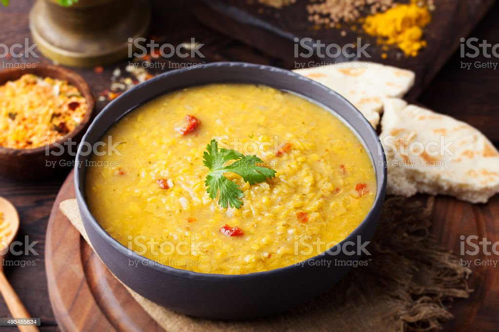 Red lentil Indian soup with flat bread. Masoor dal. stock photo