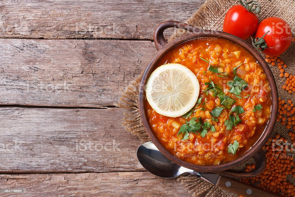 red lentil soup with lemon horizontal view from above stock photo