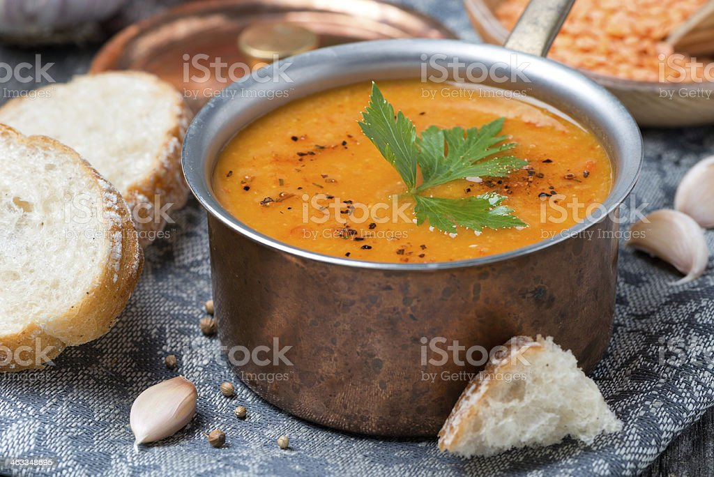 red lentil soup with spices in a copper saucepan royalty-free stock photo