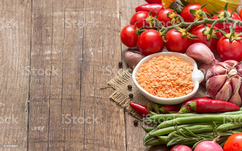 Red lentils and vegetables stock photo