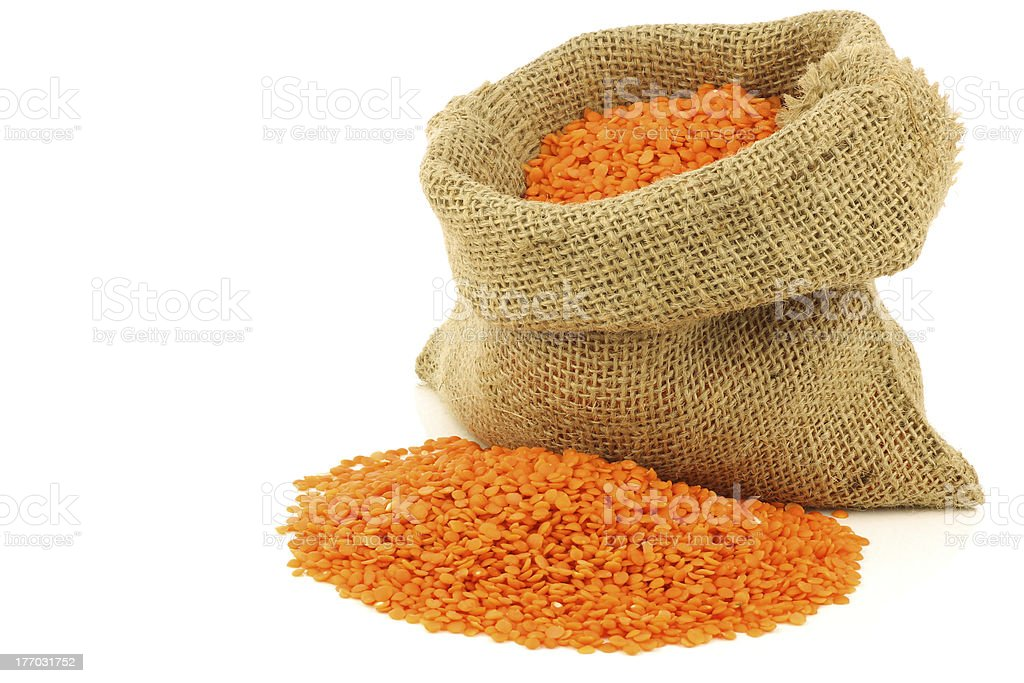 red lentils in a burlap bag royalty-free stock photo
