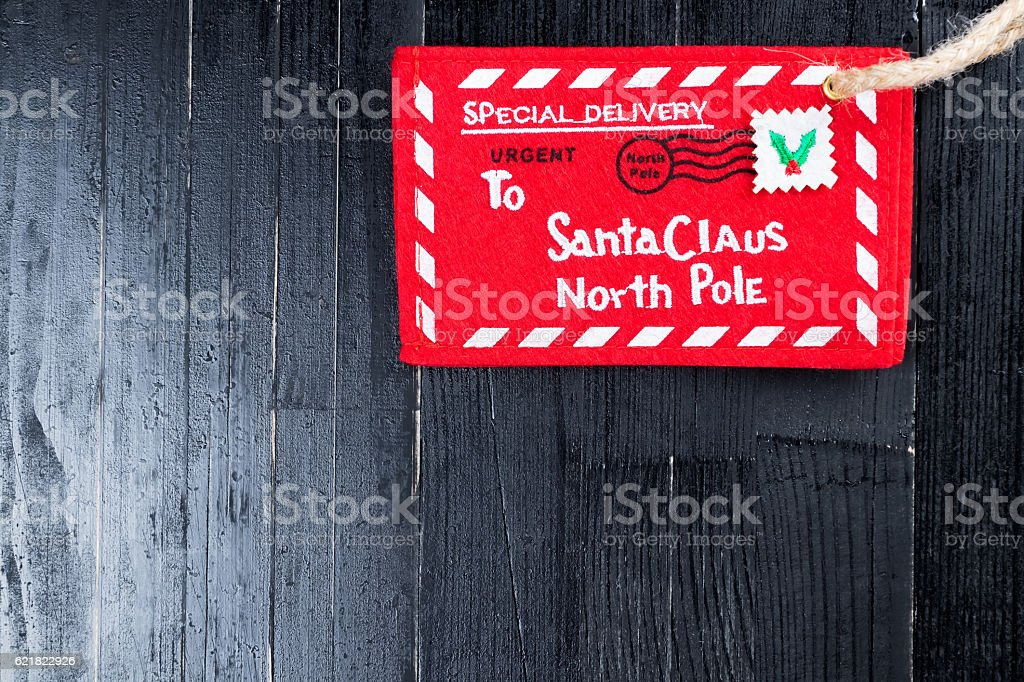 Red letter to Santa Claus envelope with jute twine attached. stock photo