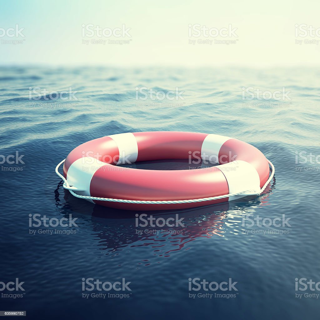 Red life buoy on the waves as a symbol of stock photo
