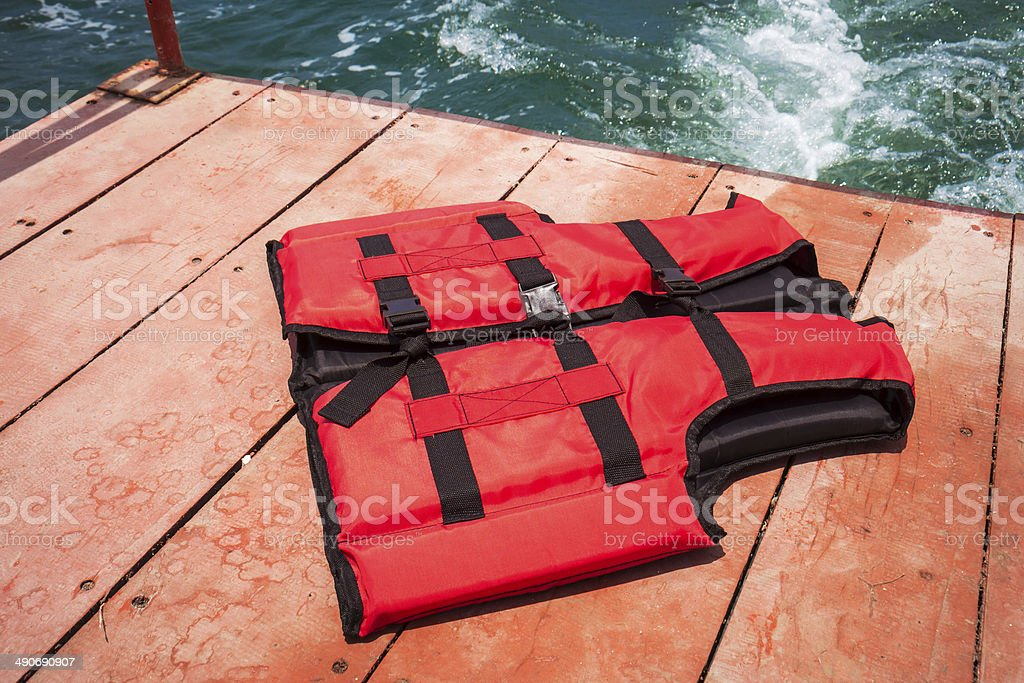 Red life jacket on boat stock photo