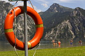 Red lifebuoy hang by mountain lake Traunsee, Salzkammergut Upper Austria