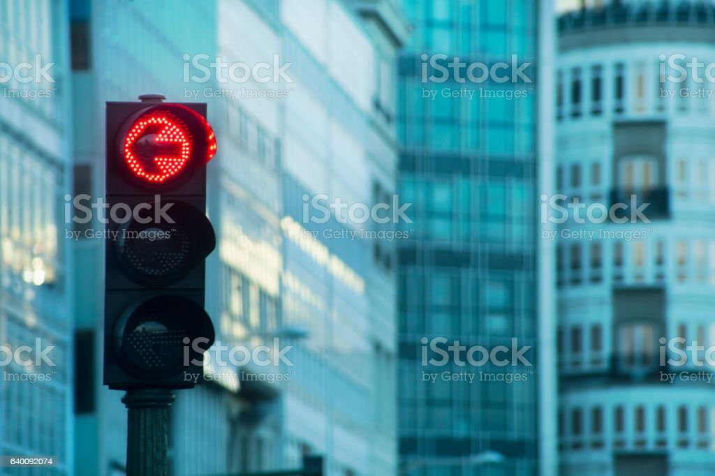 Red light and apartment buildings with galerias, city street. stock photo