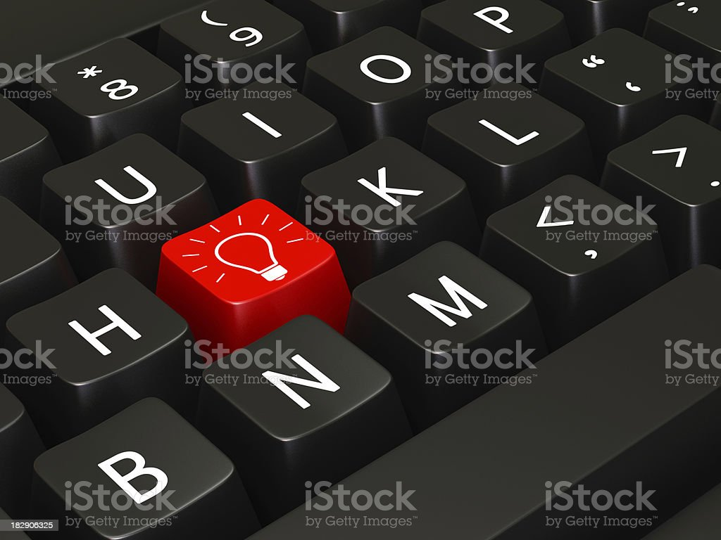 Red light bulb key on an otherwise black keyboard royalty-free stock photo