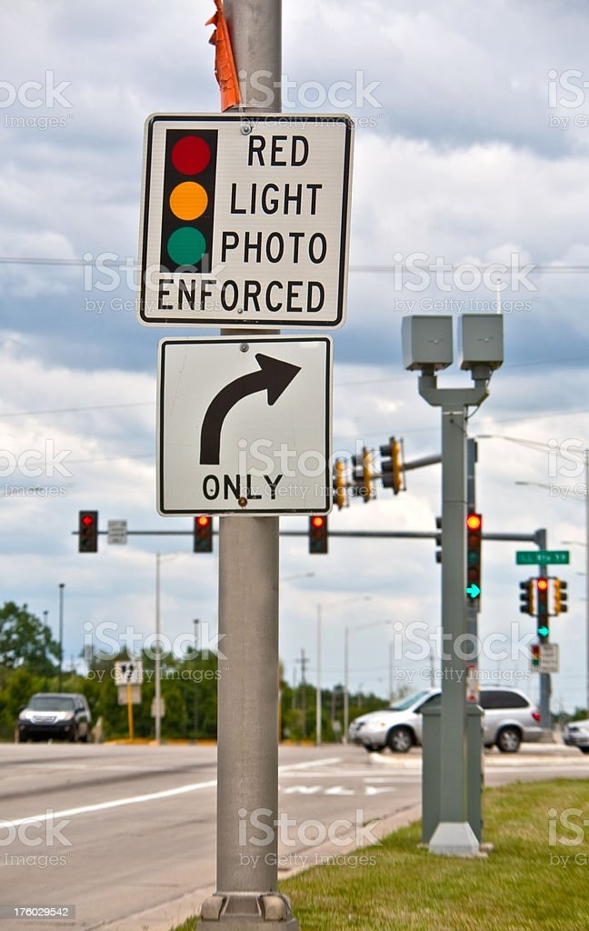 red light camera sign at intersection stock photo