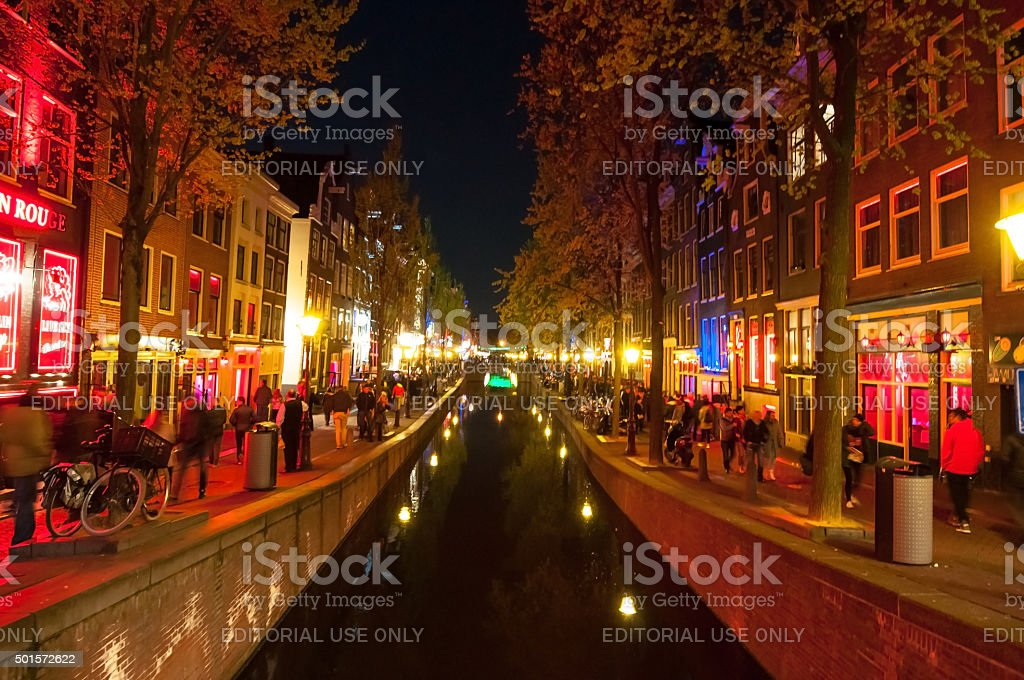 Red light district (Wallen) at night  in Amsterdam, the Netherlands. stock photo