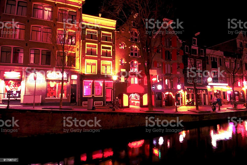 Red light district by night in Amsterdam the Netherlands stock photo