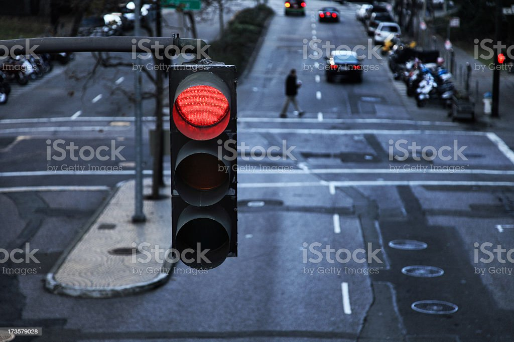 Red light hanging above a paved street in the city stock photo